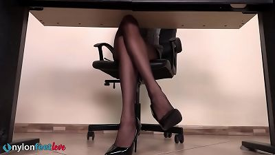 view under the desk of this secretay and enjoy her shoeplay